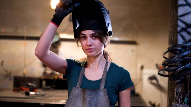 Portrait of young female welder