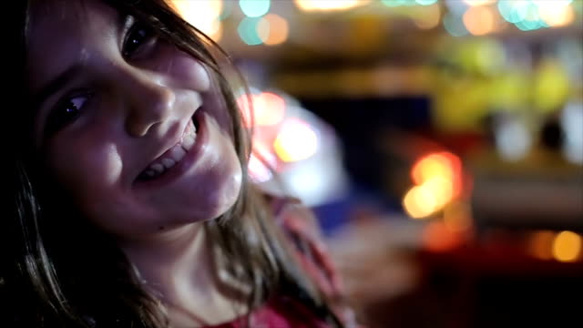 Portrait of young girl in amusement park,close up