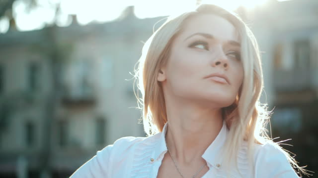 Portrait of young happy blonde business woman in the city. Slow motion. Beautiful girl in white sexy blouse in the street video
