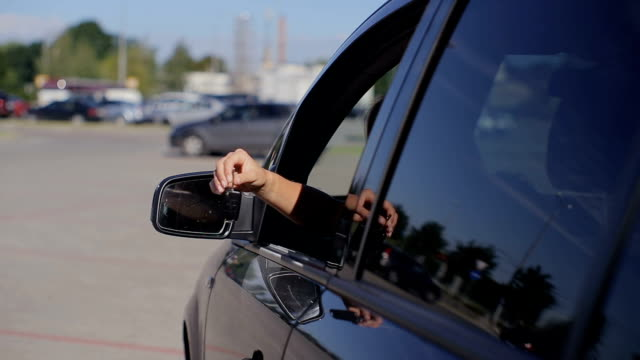 Portrait of young happy woman driving first vehicle video