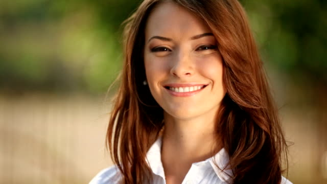 Portrait of young happy woman outdoors video