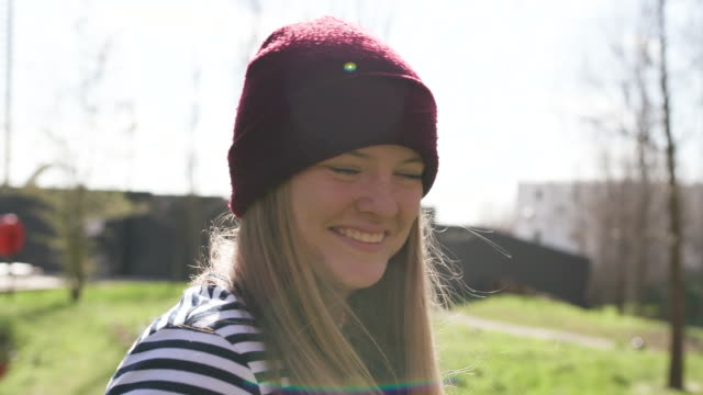 Portrait of young hipster women wearing a hat smiling to camera
