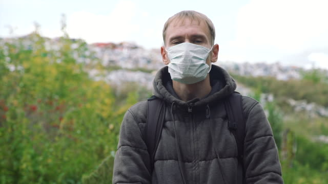 Portrait of Young Man in a Mask near a Landfill