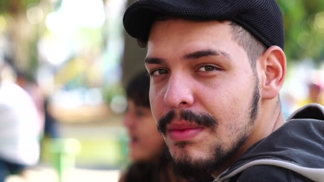 portrait of young man with girl on background - cultura latino americana video stock e b–roll