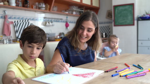 Portrait Of Young Nanny Taking Care Of Little Boy And Baby Girl video