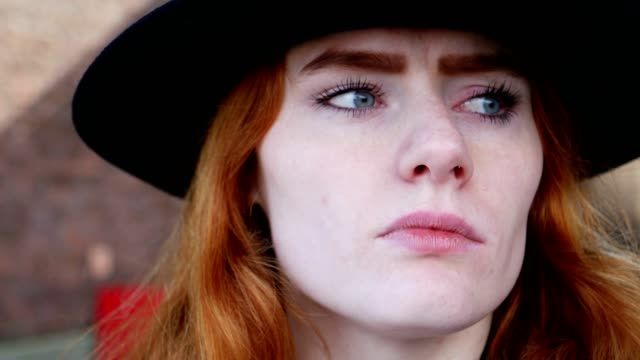 Portrait of young red haired lady close up video