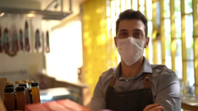 portrait of young small business man owner with face mask - mask стоковые видео и кадры b-roll
