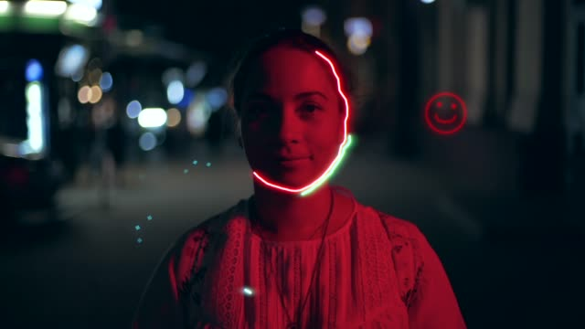 Portrait of young smiling beautiful girl or woman in red light at night with shaking camera and hand drawn glowing neon lights effect animation. Abstract modern visual luminous background with person video