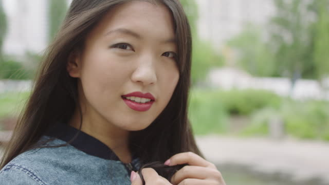 Portrait of young w asian woman with engagement ring video