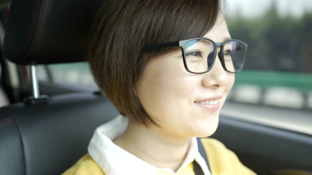 Portrait of young woman driving car Portrait of young woman driving car rear view mirror stock videos & royalty-free footage