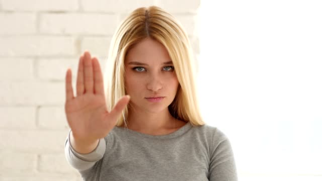 Portrait of Young Woman Gesturing Stop Sign with Hand video