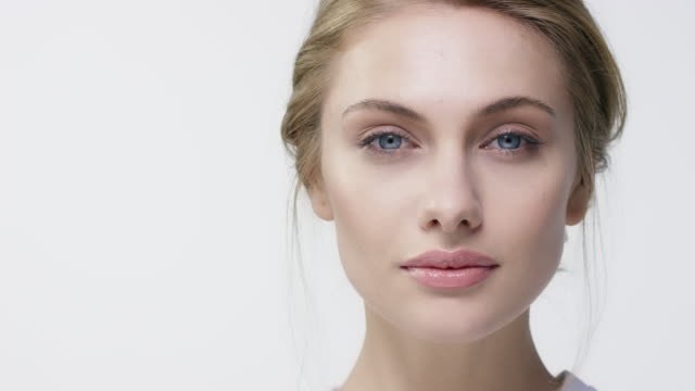 Portrait of young woman with beautiful blue eyes