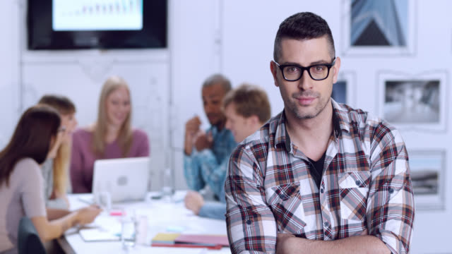 Portrait of younger man in business startup environment video