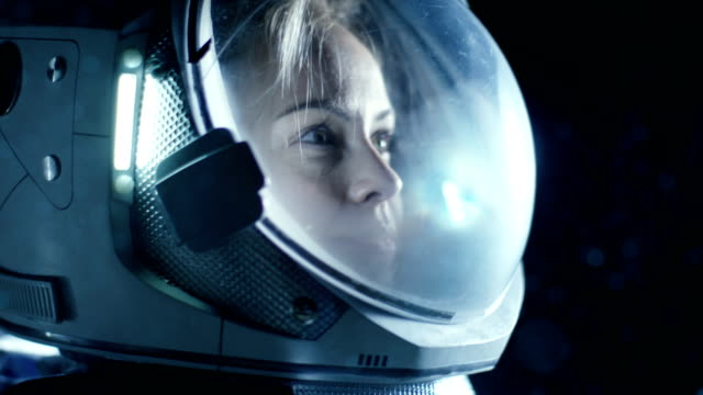 Portrait Shot of the Courageous Female Astronaut  Wearing Helmet in Space, Looking around in Wonder. Space Travel, Exploration and Solar System Colonization Concept. video
