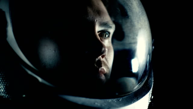 Portrait Shot of the Courageuos Astronaut  Wearing Helmet in Space, Looking around in Wonder. Space Travel, Exploration and Solar System Colonization Concept. video