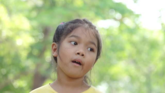 Portrait smiling girl in park
