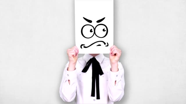 portrait, teenager holds white paper sheet with anxious, doubt smiley drawing, animation, covering face. emotions, imagination, creativity, successful idea concept - donna si nasconde video stock e b–roll