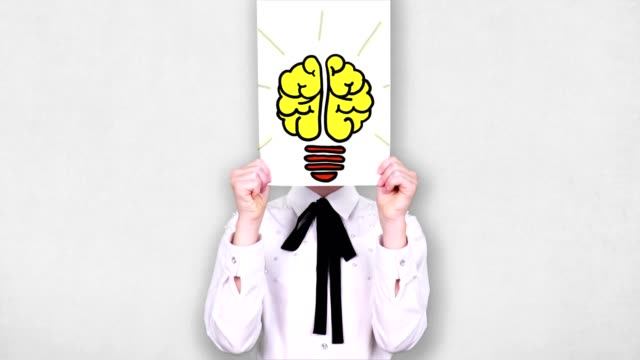 portrait, teenager holds white paper sheet with light bulb brain drawing, animation, in front of face. Imagination, creativity, successful idea concept. business , education portrait, teenager holds white paper sheet with light bulb brain drawing, animation, in front of face. Imagination, creativity, successful idea concept. business , education. genius stock videos & royalty-free footage