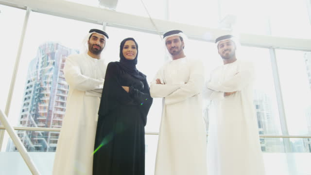 Portrait UAE business team wearing national dress Dubai video