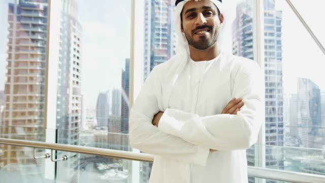 Portrait UAE businessman wearing national dress downtown office video