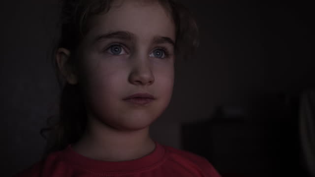portrait ð¡ute little kid while watching tv. young girl watch television on living room. concept video game, entertainment, emotions, family. child watching tv, close up face of little girl, kid eyes. - neonati maschi video stock e b–roll