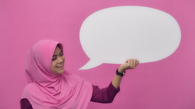 SLO MO Portrait Voice message of a beautiful Muslim woman