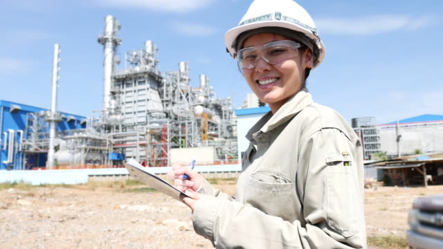 Portrait woman engineer working with Electrical Power Plant video