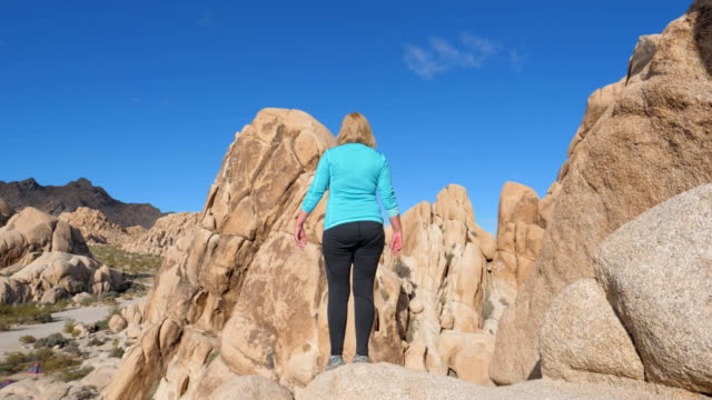 Portrait Woman Standing On The Edge Of A Cliff Raised Hands Up And To The Side video