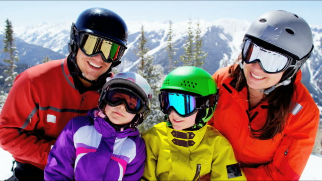 portrait young caucasian family outdoors winter mountains vacation - sci video stock e b–roll