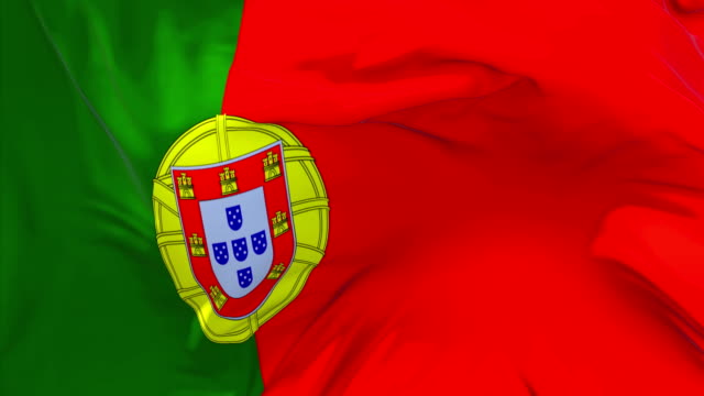 vídeos de stock e filmes b-roll de portugal flag waving in wind slow motion animation . 4k realistic fabric texture flag smooth blowing on a windy day continuous seamless loop background. - portalegre
