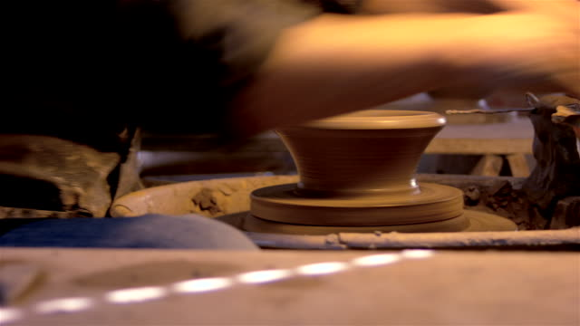Portuguese traditional handicraft. Portuguese traditional handicraft. Man working with clay. Making black pottery. art and craft product stock videos & royalty-free footage