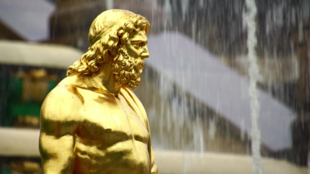 Poseidon golden statue fountain in Peterhof park in St. Petersburg Russia