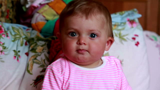 Positive baby looking at camera video