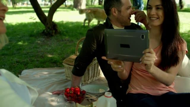 Positive couple taking photos of a senior woman video