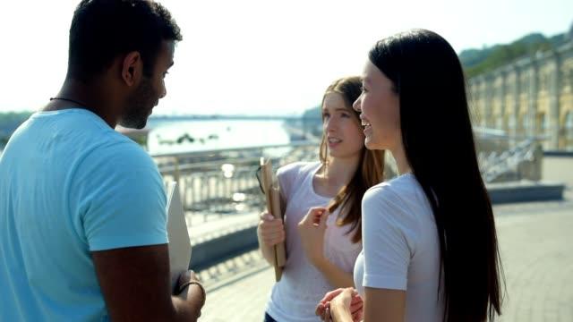 Positive groupmates communicating outdoors video