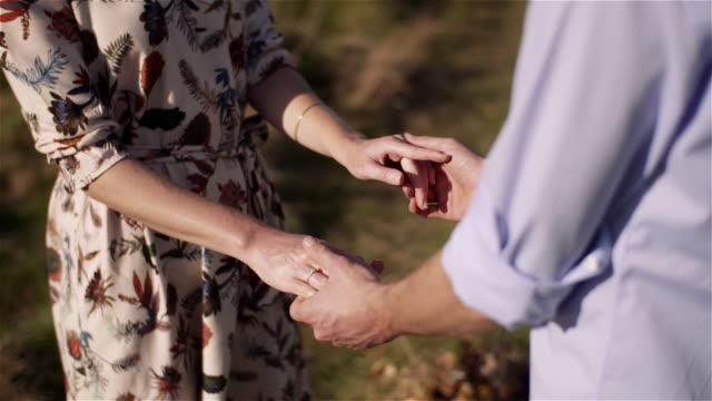 positive young happy loving couple holding hands - rappresentazione umana video stock e b–roll