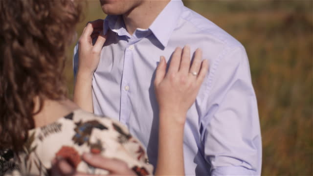 positive young happy loving couple walking on meadow in summer - rappresentazione umana video stock e b–roll