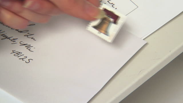 Postage Stamp 2 Sticking a postage stamp on a letter. stamp stock videos & royalty-free footage