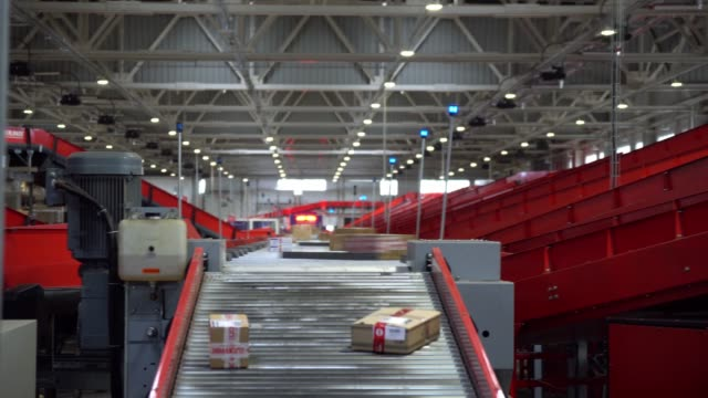 Postal Parcel Sorting Line Postal Conveyor System, Parcels are Moving on Belt Conveyor at Post Sorting Office post structure stock videos & royalty-free footage