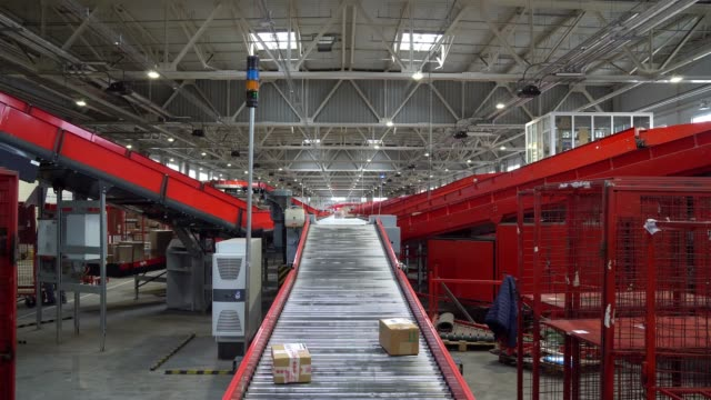 Postal Parcel Sorting Line Postal Conveyor System, Parcels are Moving on Belt Conveyor at Post Sorting Office post office stock videos & royalty-free footage