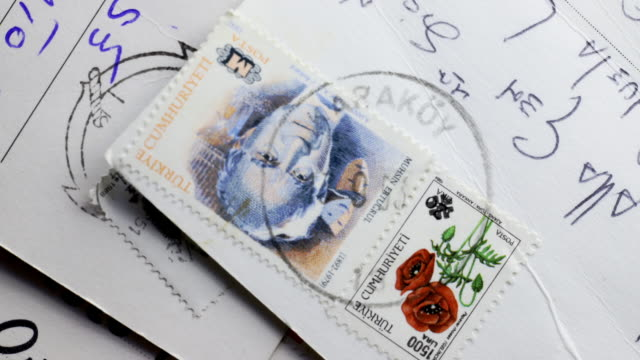 Postcards and stamps Old postards detail with beatifull colored stamps , time lapse stamp stock videos & royalty-free footage