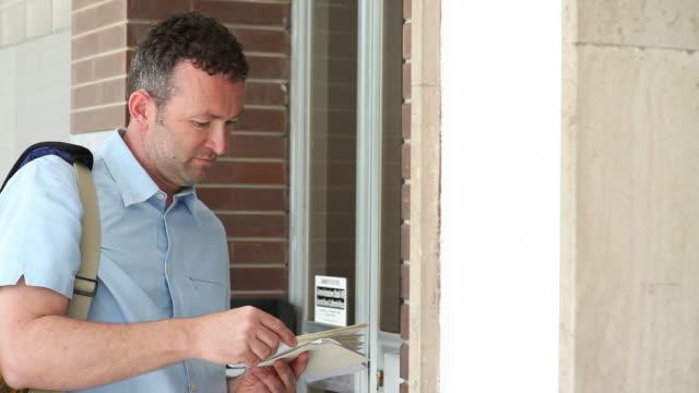 postman at work;  full hd photo jpeg - postal worker 個影片檔及 b 捲影像