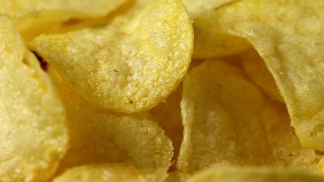 Potato chips Close up of rotating potato chips. No sound. potato chip stock videos & royalty-free footage