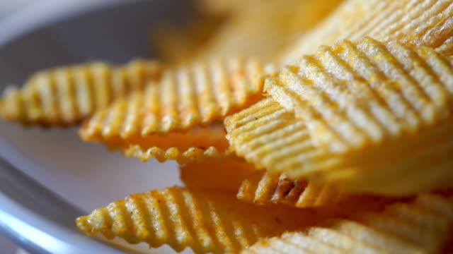 CU/Potato fries, tableware Potato spicy delicious in a rotating dish. Potato fries, tableware Potato spicy delicious in a rotating dish. potato chip stock videos & royalty-free footage