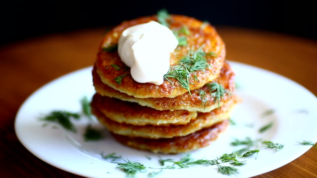 potato pancakes with dill in a plate - gusto aspro video stock e b–roll