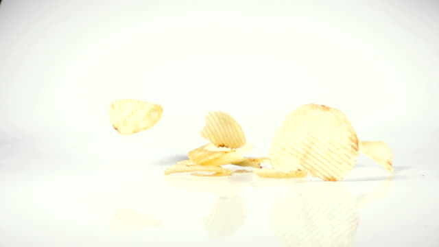 potato ship snack drop on slow-motion video