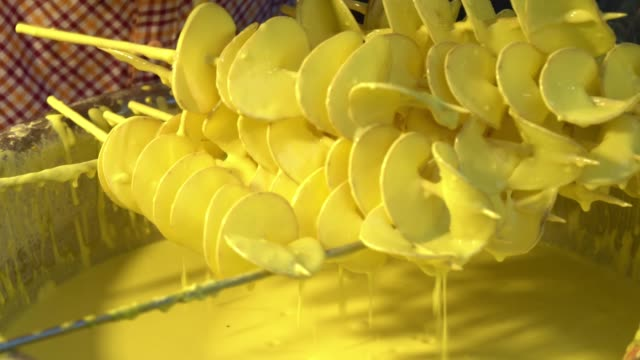 Potato skewers dipped yellow. Potato skewers dipped yellow. skewer stock videos & royalty-free footage