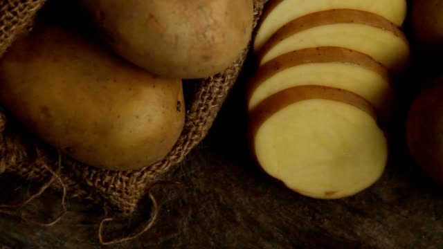 potato sliced at kitchen - patate video stock e b–roll