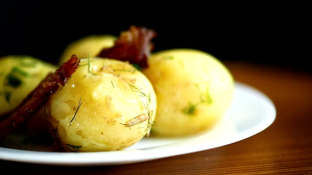 potato young boiled with fried bacon potato young boiled with fried bacon on a plate cooked stock videos & royalty-free footage