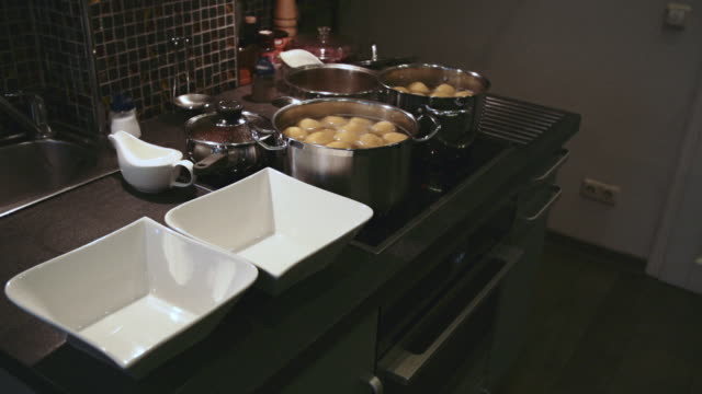 Potatoes Boiling in Home Kitchen